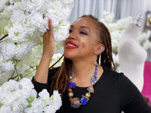Black woman smelling white flowers